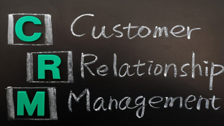 Acronym of CRM - Customer Relationship Management written on a blackboard